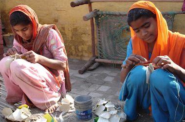 Children making soccer balls for the Indian domestic market.